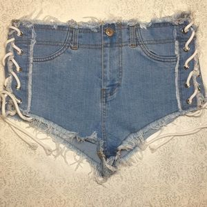 Distressed jean laced sides booty shorts